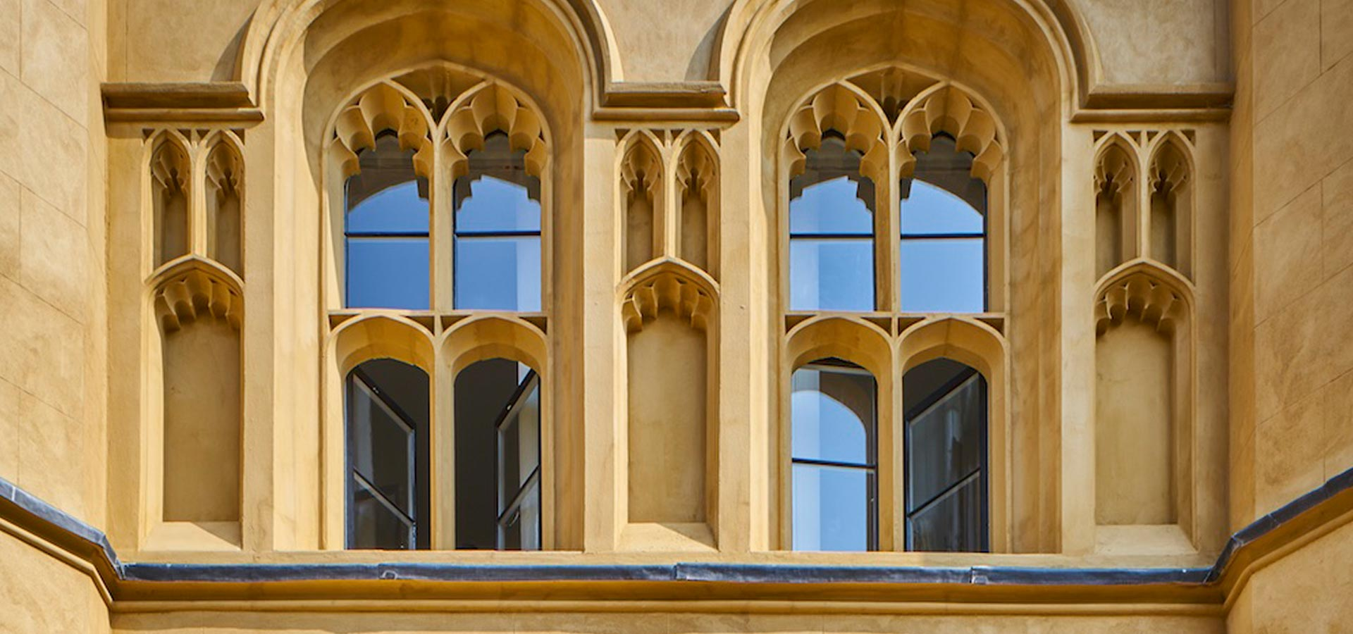 A heritage mansion with double gazed custom made arched windows